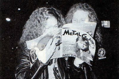 Jason Newsted and James Hetfield reading a copy of Metal Gear with Lars Ulrich on the cover