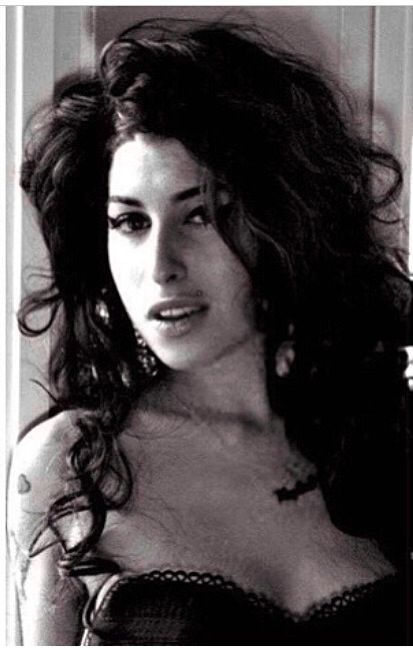 Amy Winehouse. How she looked when I first watched her sing. Amazing voice. Sad life.