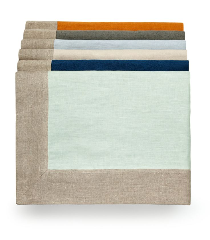 Pure linen throws with a natural border in five colours - Saffron, Slate Grey, Parma Grey, Putty, Prussian Blue & Sea Green