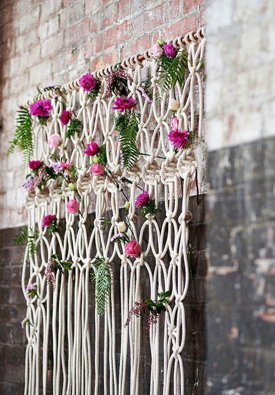 Bohemian macrame knotted backdrop with flowers / http://www.deerpearlflowers.com/boho-macrame-knotted-wedding-decor-ideas/