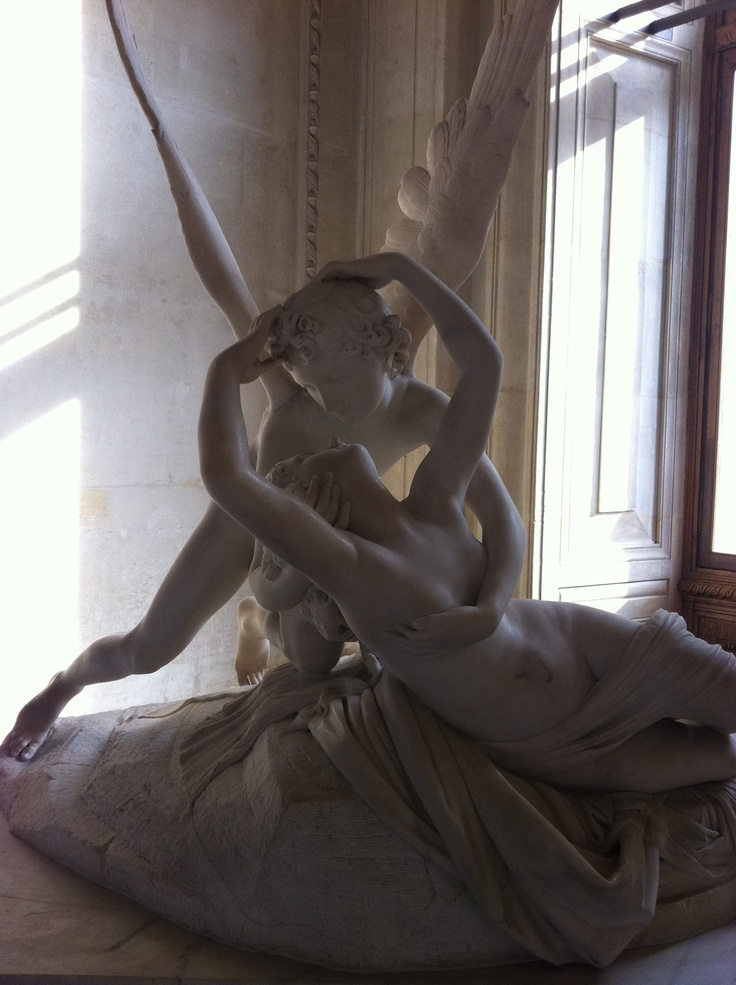 A women embraced by a beautiful arch angel-photo taken September 2011, Musee du louvre, PARIS
