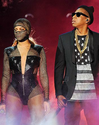 Beyonce and Jay Z kicked off their On the Run Tour in Miami. Bey rocked a plunging neckline bodysuit by Atelier Versace and matching netted headpiece. Check out the video of their performance!