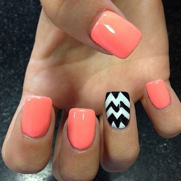 Orange nails with accent black&white chevron. Looks amazing. I'm definitely trying this look this summer!!