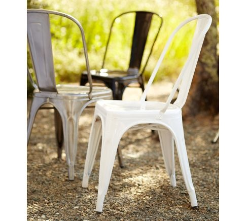 Classic French Tolix cafe chairs are the epitome of garden chic