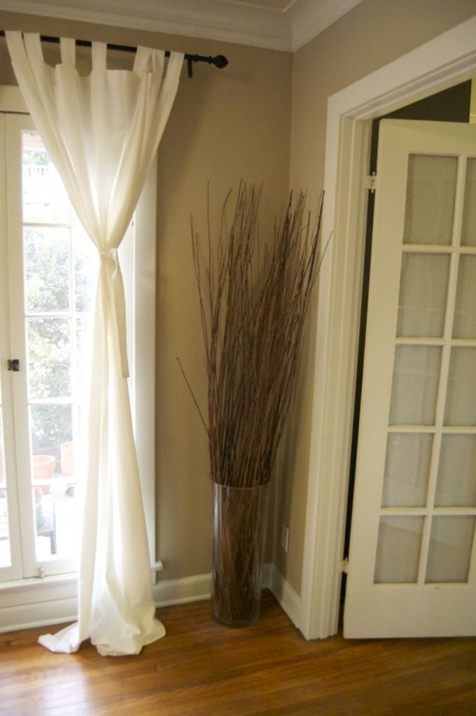 love the twigs in the vase love the wall color love the curtains love the floor love the doors