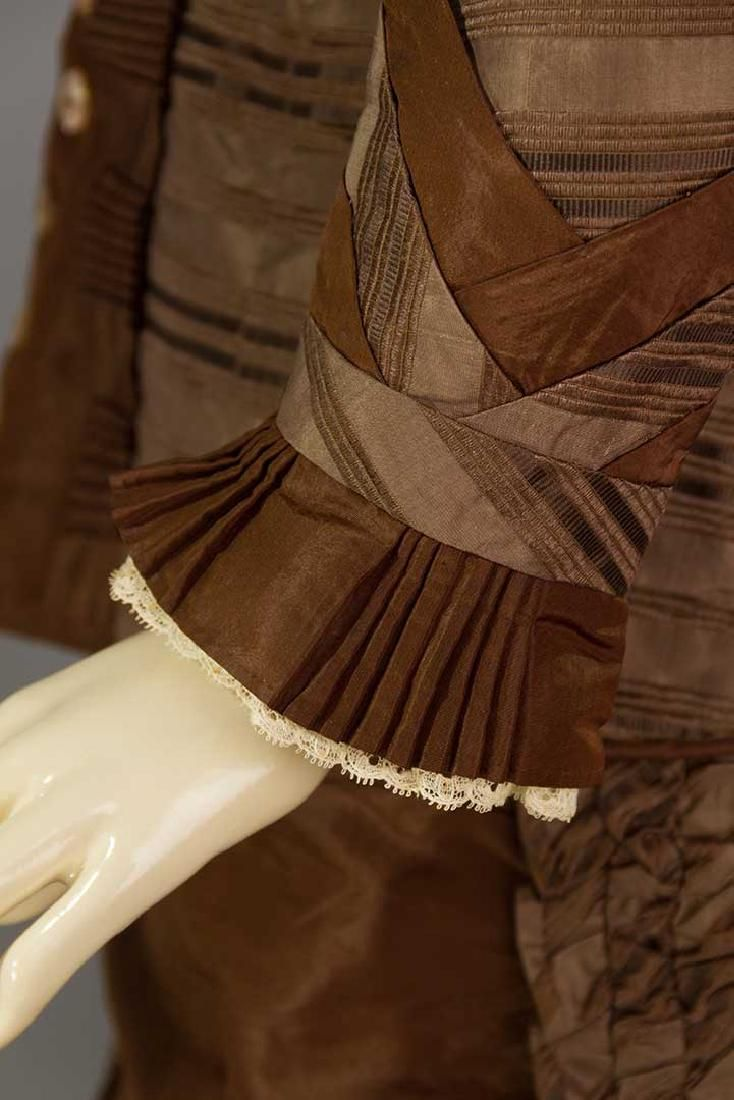 Lot: BROWN STRIPED SILK BUSTLE DRESS, 1870s, Lot Number: 0232, Starting Bid: $100, Auctioneer: Augusta Auctions, Auction: COUTURE, HISTORIC & VINTAGE CLOTHING AUCTION, Date: May 9th, 2017 CDT