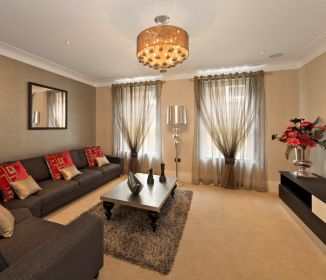 sectiona;, curtains and area rug are perfect pieces for this living room