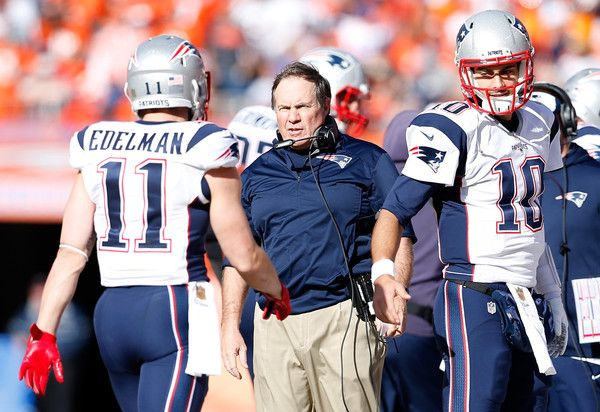 Julian Edelman Photos Photos - Head coach Bill Belichick of the New England Patriots speaks to Julian Edelman #11 in the first half against the Denver Broncos in the AFC Championship game at Sports Authority Field at Mile High on January 24, 2016 in Denver, Colorado. - AFC Championship - New England Patriots v Denver Broncos