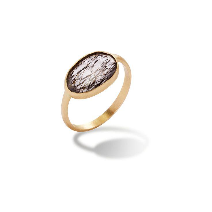 14-karat gold unique ring with quartz