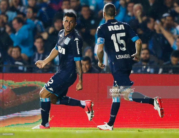 Enrique Triverio of Racing Club celebrates with teammate Lisandro Lopez after scoring the first goal of his team during a match between Racing Club and Temperley as part of the Superliga 2017/2018 on September 09, 2017 in Avellaneda, Argentina.