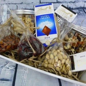 This hamper includes two nutty jars, a bag of yummy dried fruit, a bag of almonds, a bag of pistachios and three bars of luxury chocolate.  http://littlepressie.com.au/store/ultimate-healthy-hamper/