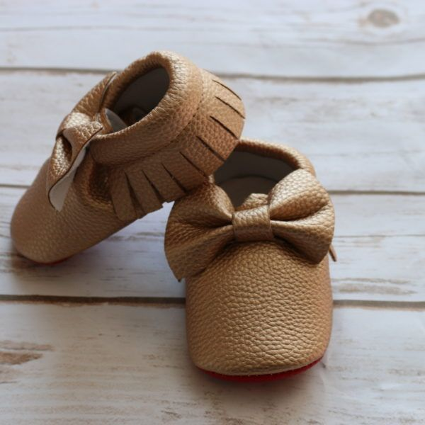These adorable rose gold colored baby moccasins are the perfect addition to your little girls wardrobe.  Created for the mom who cares about fashion for their little one. Baby girls will look so cute in these red soled baby moccasins.  20% of the proceeds going to support foster care initiatives and orphaned children in Nicaragua.