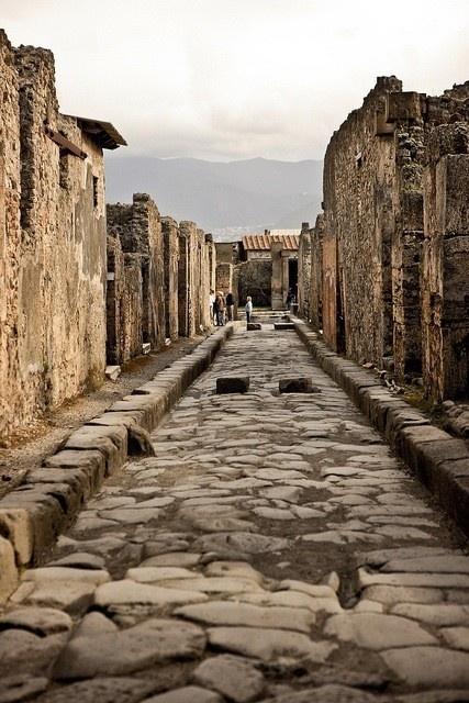 """Pompeii FUN FACT: this """"road"""" shown isn't really a road, it is in fact, the sewer that would run through the city... those two little raise stones are for crossing to the other side of the sidewalk with out stepping in waste."""
