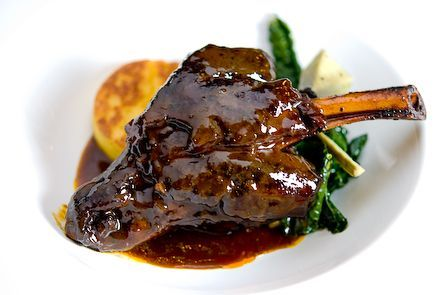 Braised Lamb Shanks:  4 lamb shanks  salt and freshly ground black pepper  1/2 cup canola oil  2 celery stalks, chopped  2 carrots,chopped  1 large onion, chopped  1/2 cup tomato paste  2 cups red wine  3/4 cup white wine  6 sprigs fresh thyme  2 bay leaves  2 teaspoons whole black peppercorns  2 teaspoons juniper berries  4 anchovy filets, chopped  1 whole head garlic, cut in half  1/4 cup white vinegar  1 cup demi-glace  2 cups Chicken Stock