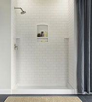 Swanstone Products, tub/shower walls. A compromise between my love of tile and Sam's love of low maintenance.