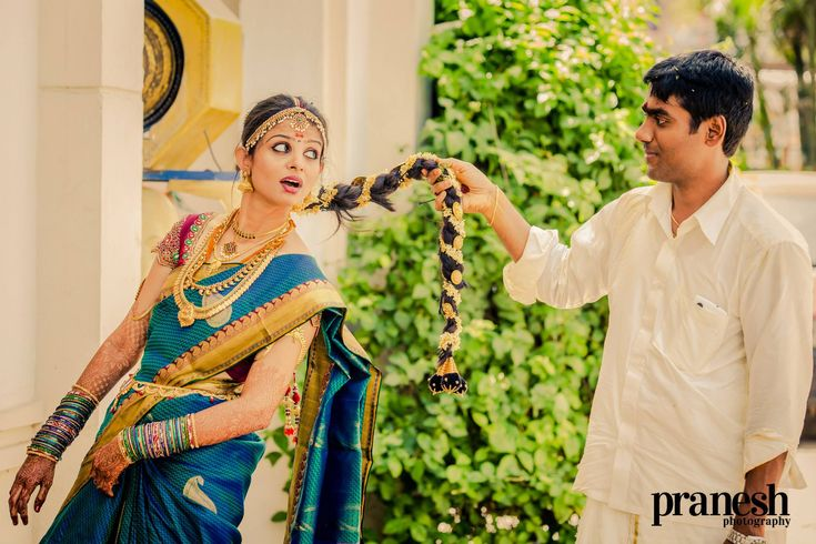 Indian wedding photography. Couple photo shoot ideas. Candid photography. Traditional Southern Indian couple. Bride wearing bridal saree, jewellery and hairstyle. #IndianBridalMakeup