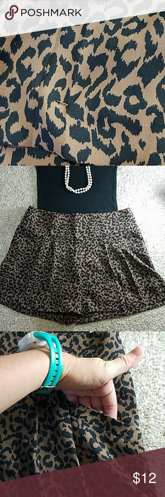 ANNE TAYLOR LOFT | Cheetah Shorts With Pockets Very light, float and lovely! 100% polyester. Pockets on each hip. Needs a little fix to the hem on the right side (But safety pin shown has been doing the trick just fine!). Priced accordingly. Smoke free home and fast shipping! Ann Taylor Shorts