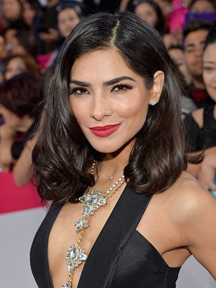 Alejandra Espinoza's shoulder-length hairstyle, red lipstick, and dramatic lashes | allure.com