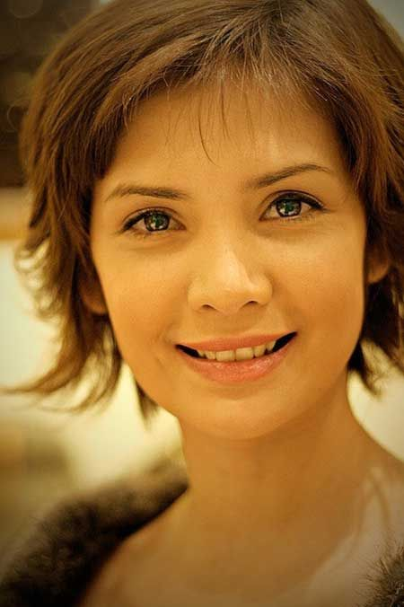 Cute Short Hairstyle with Flyaway Fringes