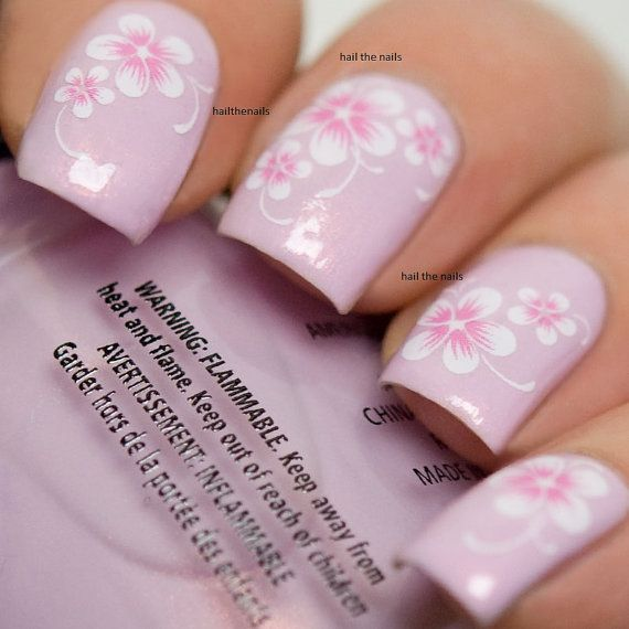 20 mixed decals on a clear water transfer which can be applied over any colour varnish on either your natural or false nail. Really easy to apply &