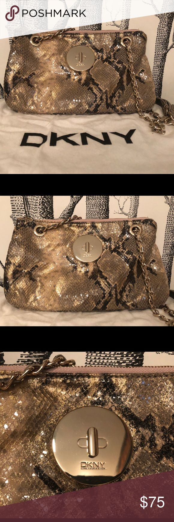 DKNY snake print leather evening bag DKNY snake print leather handbag. Great for night or daytime use. Strap can be crossbody or made shorter as a shoulder bag. Gorgeous gold details.  Never been used. Dust bag included. Dkny Bags Shoulder Bags