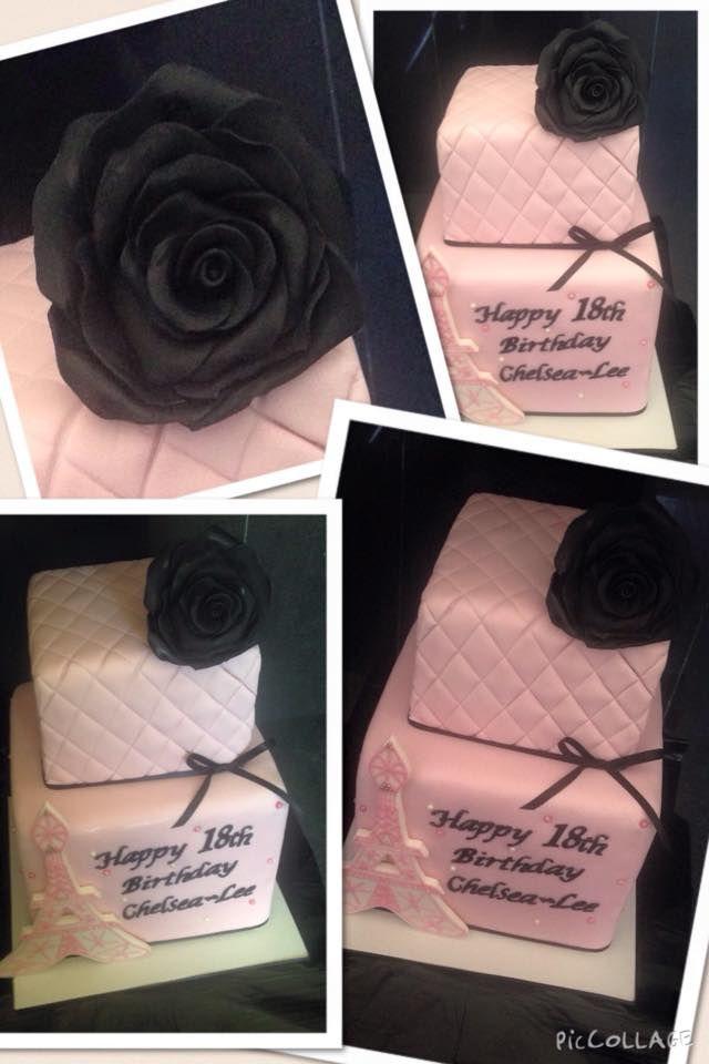 "2 tier vanilla with strawberry swirl, pink ganache, ""Paris"" themed cake. Handmade black rose and Eiffel Tower."
