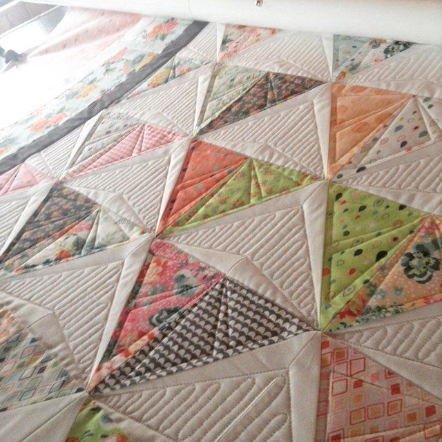 Finishing up this fun triangle quilt this afternoon. You don't think she'd mind if I just kept this quilt for Little Miss since I haven't started her quilt yet??? A girl can dream! I think I need to order some of this fabric for Little Miss anyone remember the line? TIA! #rubybluequilts #rebeccasilbaugh #fmq #freemotion #longarmquilting #customquilting #hqfusion #handiquilter #battgirls #quiltersdreampoly #quiltsidontwanttogiveback by rubybluequilts
