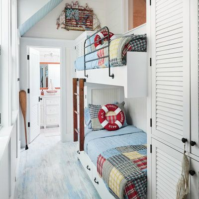 Whitewashed floors and colorful bedding give this bunkroom a playful, beachy vibe.