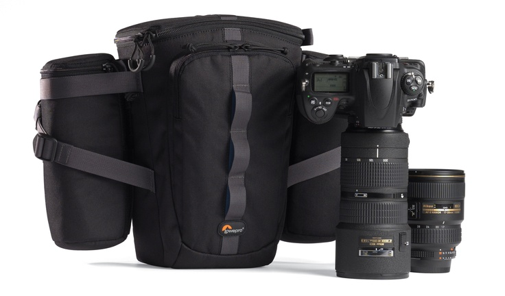 """Lowepro Outback 200  For photographers who carry their gear to the limits-on foot, bike, hike or on assignment-Outback modular beltpacks provide protection and freedom of movement. Unzip the fast-access lid and immediately """"work out of the bag"""" plus grab memory cards from the built-in pockets. Each of the three beltpack models come with two interchangeable lens/accessory cases attached by SlipLock™ loops  http://www.interfoto.co.in/products/outback_200/321/42"""