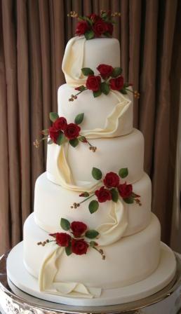 red and cream wedding cake   Designed by Melanie Ferris Cakes