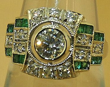 Stuning natural emerald set in Russian art deco style with large cubic zirconia centre Size - N Kaiserman Jewellers has been around since 1926. Kaiserman use ea