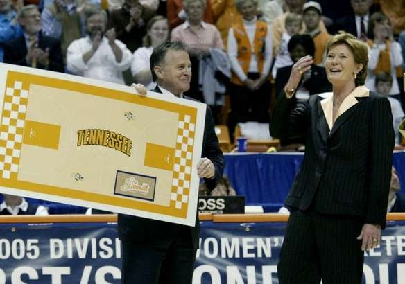 """UT president John Peterson presents Lady Vols coach Pat Summitt with the design of the Thompson-Boling Arena Floor, which will be called the """"The Summitt"""" the presentation followed UT's 75-54 win voer Purdue Summitt an NCAA record 880 career victories. - -UT coach Summitt with a design of the new floor which will be named in her honor. She broke the NCAA record of 880 all-time victories. UT played Purdue at the NCAA Women's Regional second round Thompson-Boling Arena in Knoxville, TN on…"""