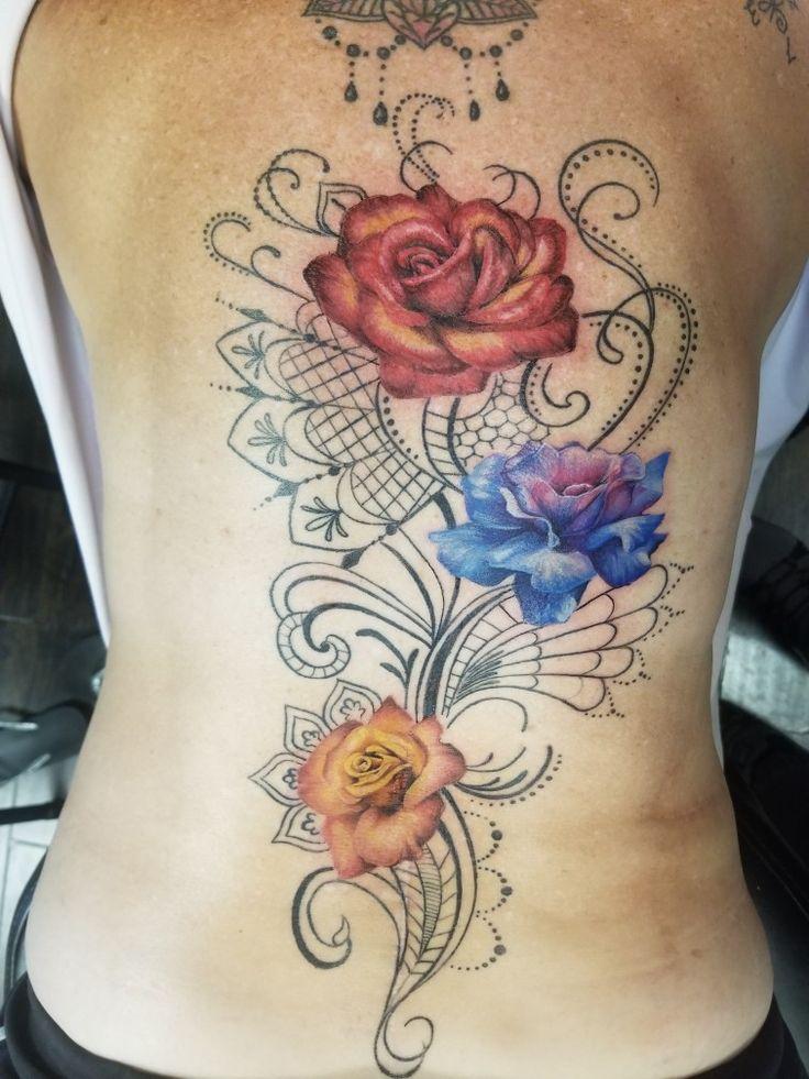 Multicolored roses spine tattoo tattoos spine tattoo