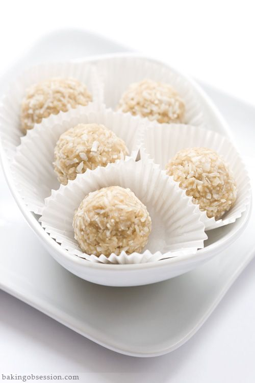 "Coconut ""Truffles"" - This is, probably, the easiest sweet treat ever. There's no chocolate in these things, but ""truffles"" sound so much more interesting than ""balls"", so I decided to name them that. My apologies, if I confused and disappointed anyone. They are also nut-, gluten-, and dairy- free, raw, and delicious! 