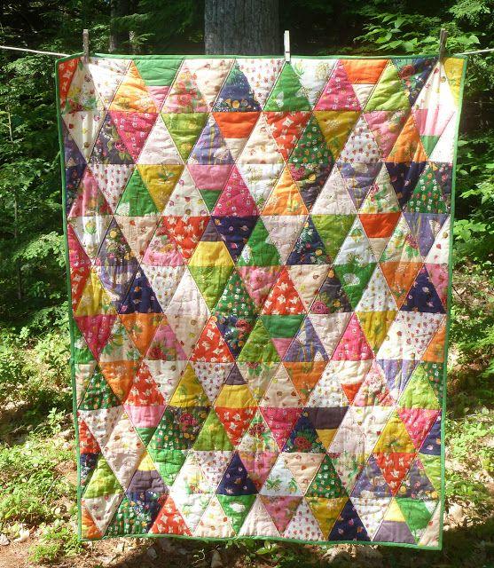 alidiza - Siesta Anyone?  Triangle quilt made with Heather Ross' Sleeping Porch fabrics.