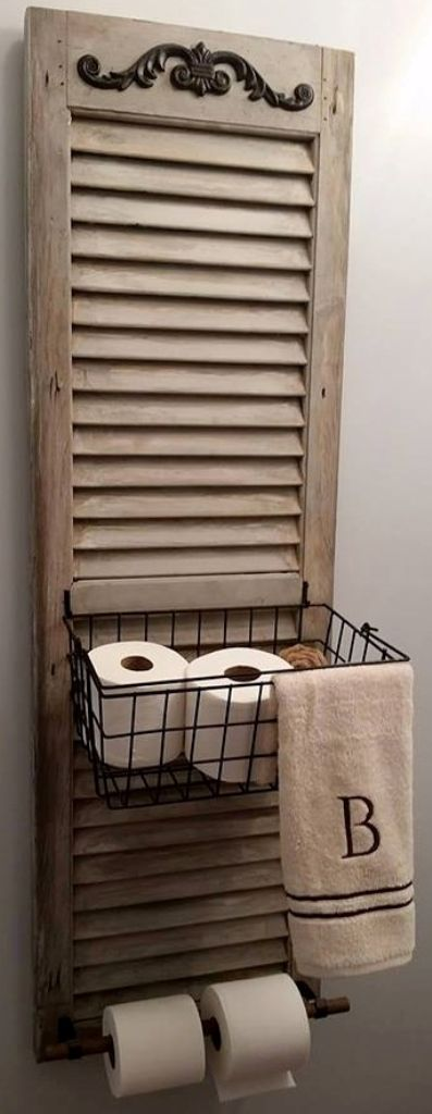 Use old shutters as holders for toilet paper and towels