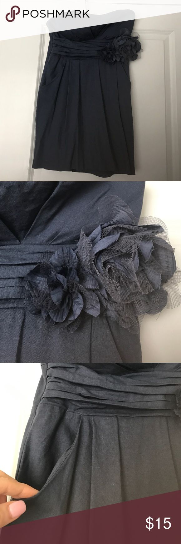 Strapless linen navy mini dress Size Medium (small medium) strapless navy linen mini dress. Has two front pockets and flower detail. Perfect for a beach date! pretty good Dresses Mini