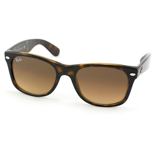 A shiny havana tortoise shell frame highlights these 'New Wayferer' sunglasses from Ray Ban. These designer frames are finished with brown gradient lenses, silvertone corner accents and 100-percent UV