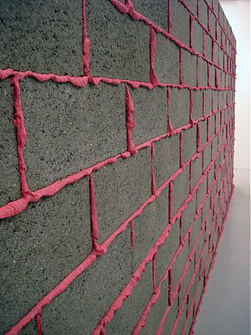 Cinder block wall with hot pink colored grout. Could be a cool retaining wall in the garden?