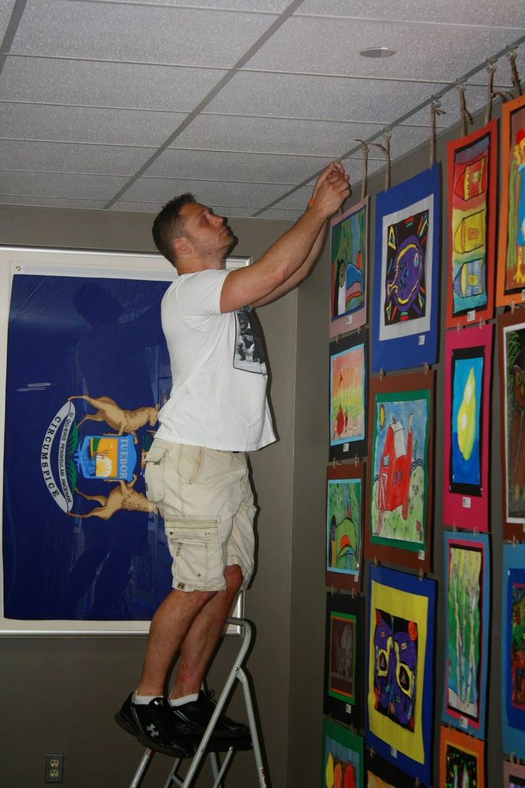 awesome! make a tapestry out of artwork and hang it on a rod (in the front office!)