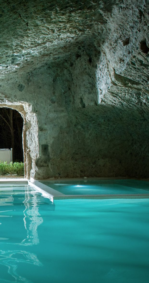 Pool built into a cave by Domus Civita by Studio F
