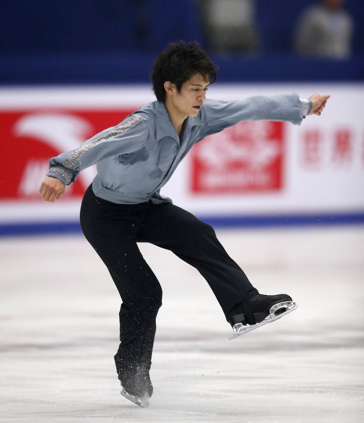 Japan's Takahiko Kozuka performs at the men's free skating programme during the ISU Grand Prix of Figure Skating in Beijing, November 2, 2013. REUTERS/Kim Kyung-Hoon (2581×3000)