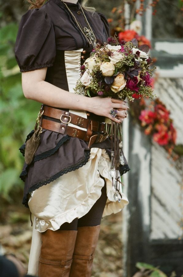 Steampunk bridesmaid--not my thing, but I do like the idea of them wearing leggings and boots