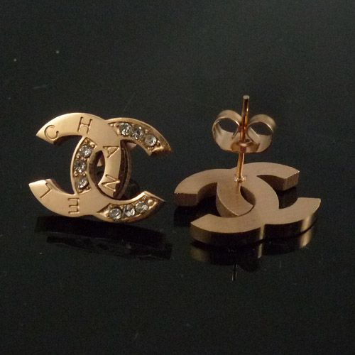 gold Chanel stud earrings