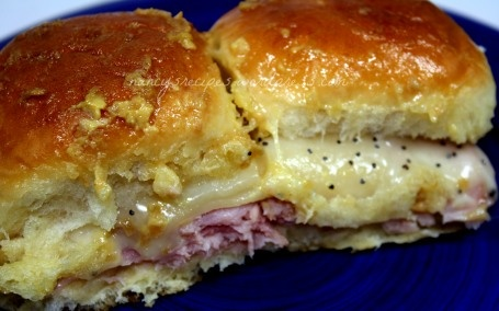 Hawaiian Ham Sandwiches--these were so easy to make and so good too! The family ate them right up! I did use ham from a regular bone in picnic ham instead of the deli meat. I would also like to try it with other cheeses--like something smokey. Very good!