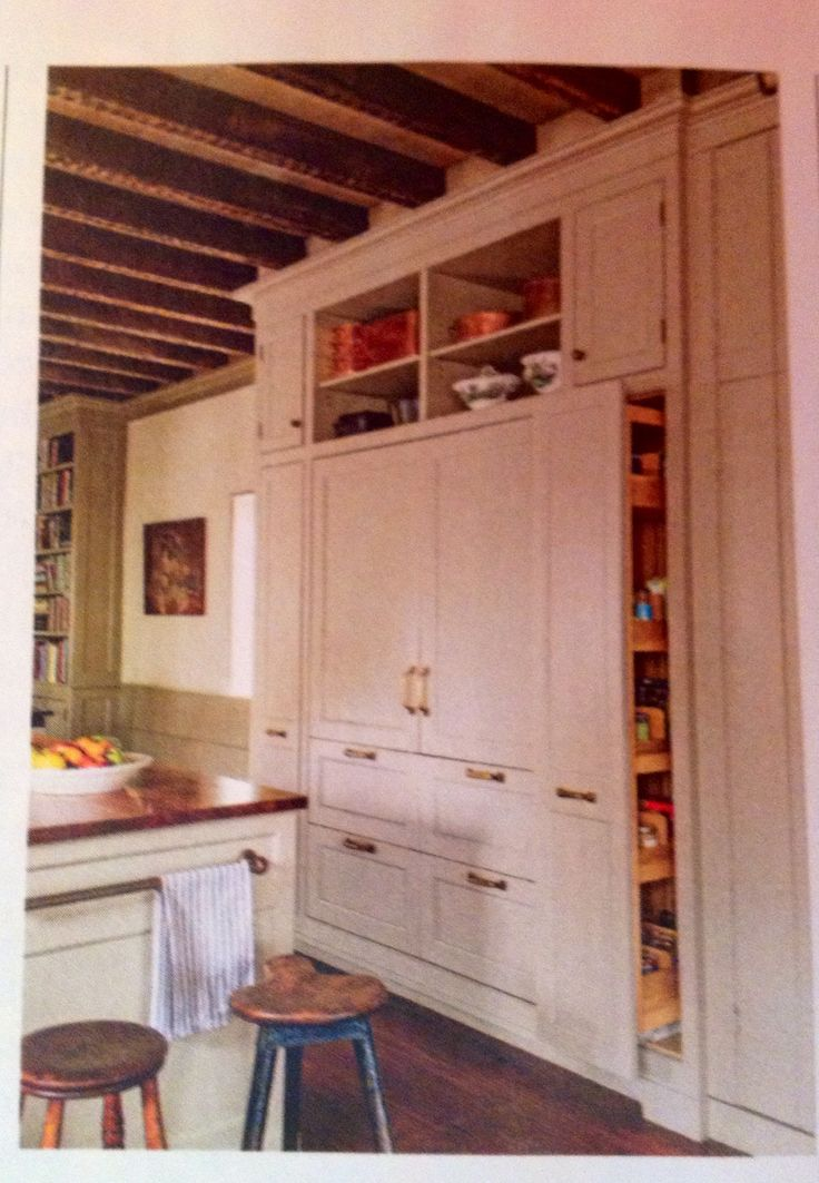 Built-in refrigerator. Pull-out side cabinets. (Feb