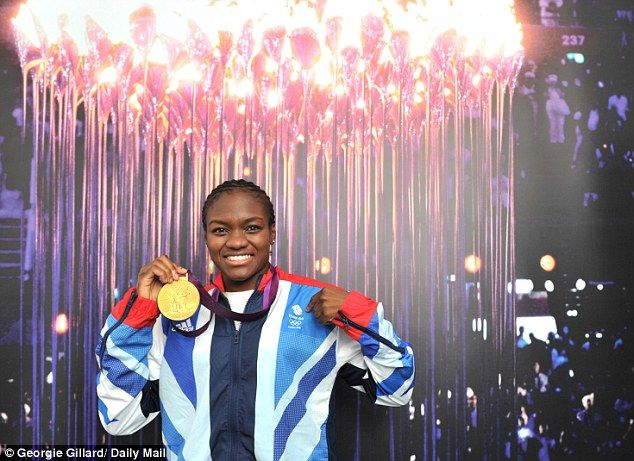 Gold rush: Amir Khan wants to take Olympic flyweight champion Nicola Adams under his wing
