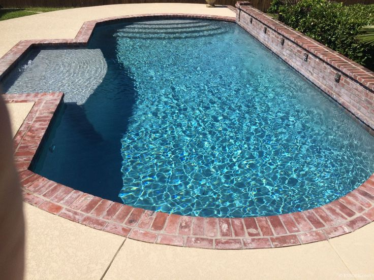 Small inground Pool with tanning ledge