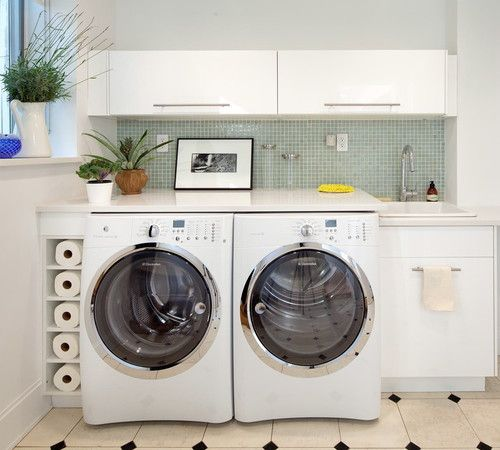 folding counter over washer and dryer (good idea) and shelving on top.  Add drying bar would be better!