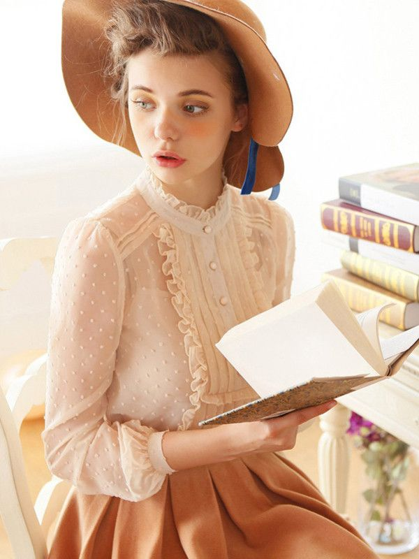 What a dainty sheer blouse! It looks like something straight out of the Edwardian era.: